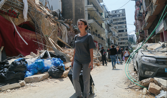 A woman leaves her home in Achrafieh.