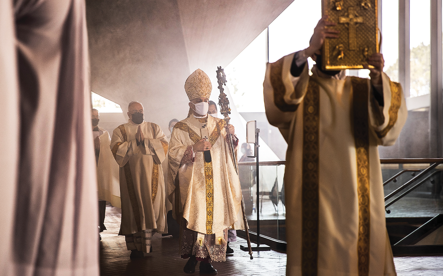 Archbishop Salvatore Cordileone (center) enters during an in-church Easter Mass celebration at the Cathedral of Saint Mary of the Assumption in San Francisco.