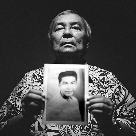 Leo Tudela, who accuses a scoutmaster of sexually abusing him, holds a picture of himself as a youth.