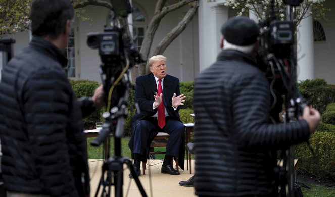 Donald Trump speaks during a virtual town hall in the Rose Garden of the White House on March 24.