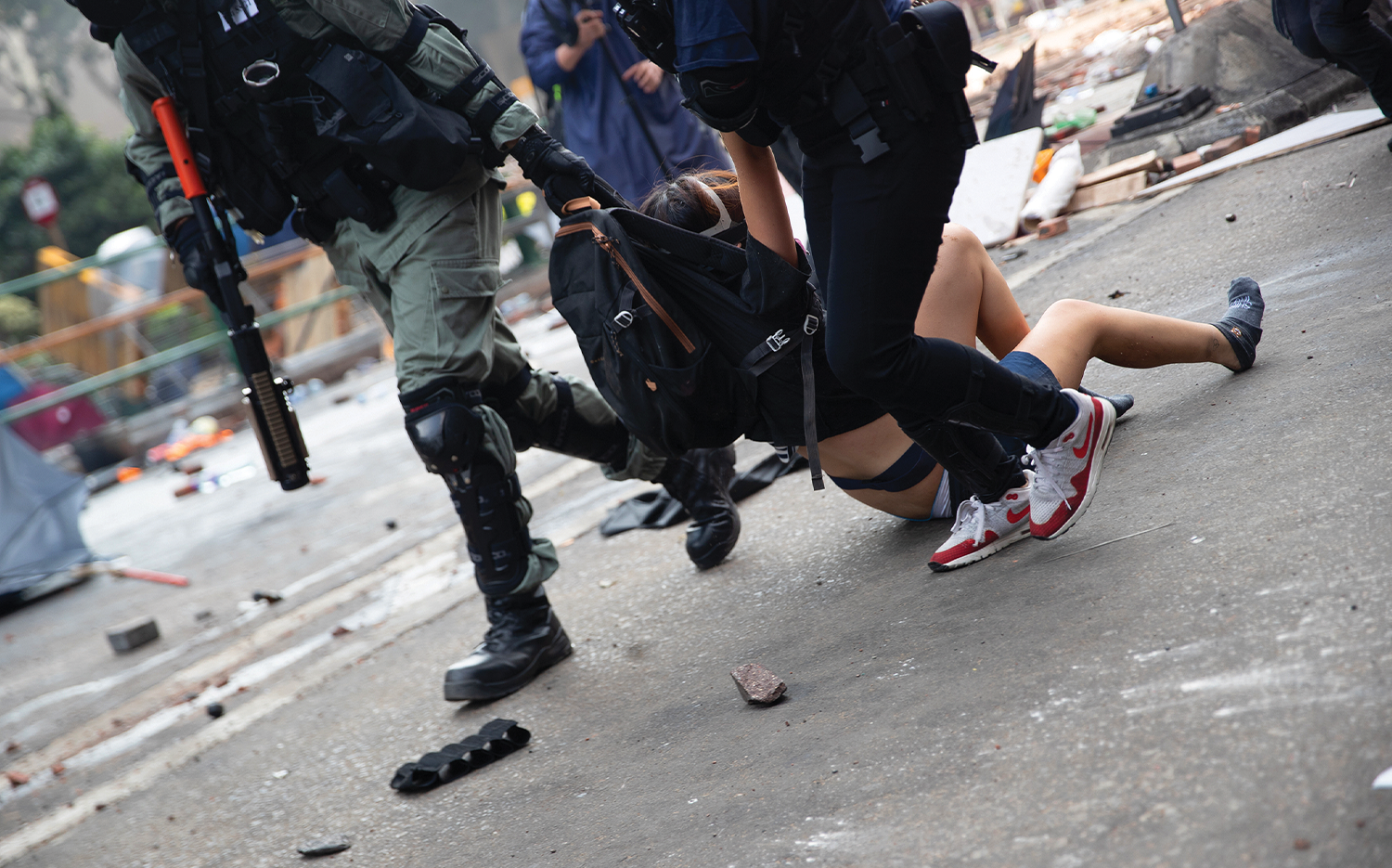 During the 2019 siege at PolyU, Hong Kong police arrest a student.