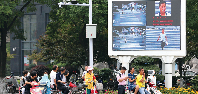 Facial recognition equipment and a screen are installed at an intersection to shame jaywalkers in Xiangyang, in China's Hubei province.