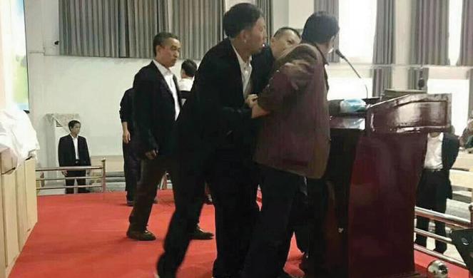 A Henan pastor is arrested midservice.