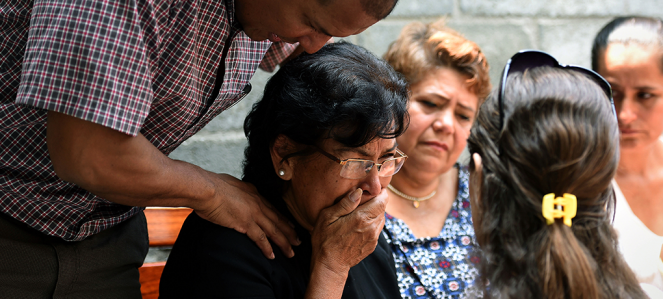 Relatives mourn an indigenous leader killed in the mountains near Tumaco.