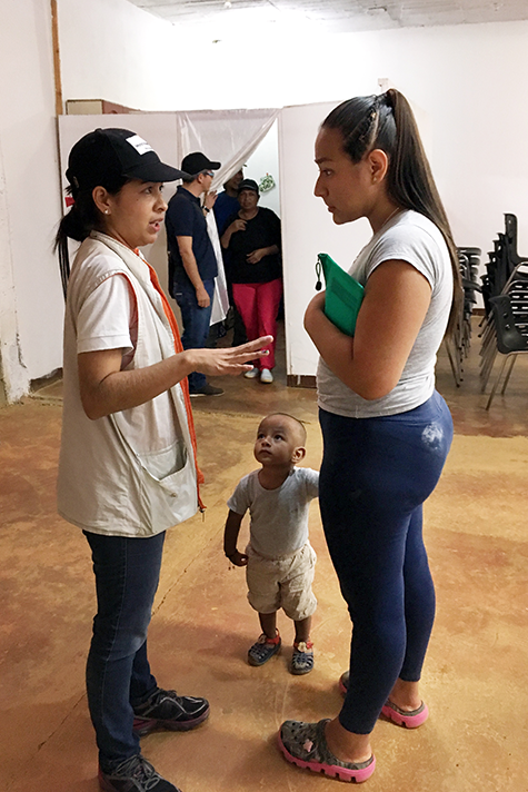 A World Relief worker gives instructions on child health