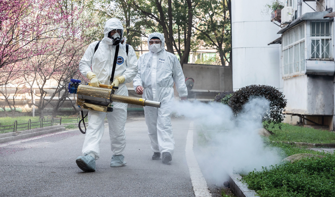 Volunteers disinfect a residential area in Wuhan.