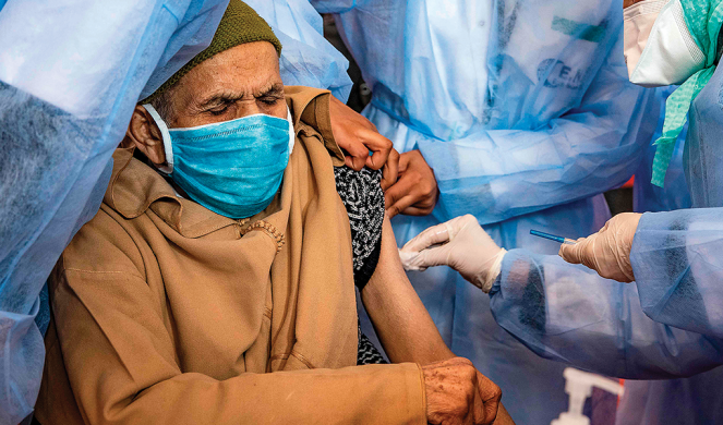A Moroccan man receives a dose of the COVID-19 vaccine.