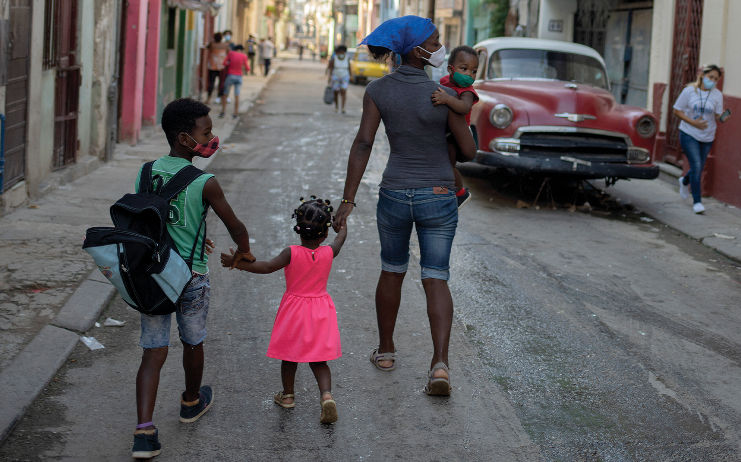 A family walks through the streets of Havana two days after the protests.