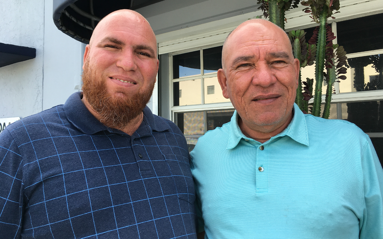 """Cubans are """"just asking for simple things. For milk. For food. For liberty. That they can go and live a regular life."""" —Jatniel Peréz (left), with his father, Daniel"""