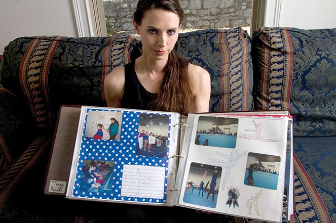 Denhollander shows her gymnastics scrapbook.