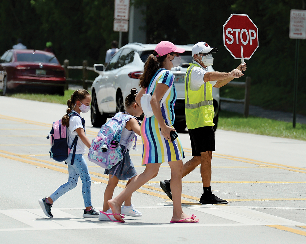 Parents pick up their children from Riverglades Elementary School as Public schools open in Broward County, Fla.
