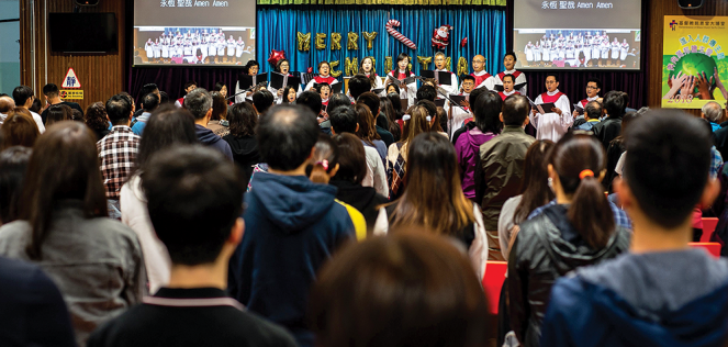 During a church service in Hong Kong, several members of the congregation wear black in support of Early Rain and other underground churches.
