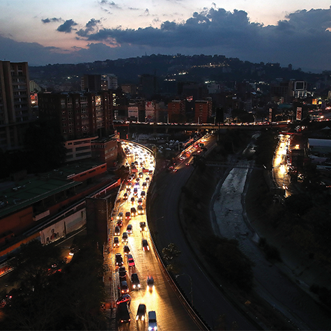 People cross through the low waters near the Simón Bolívar International Bridge in Cúcuta, Colombia.