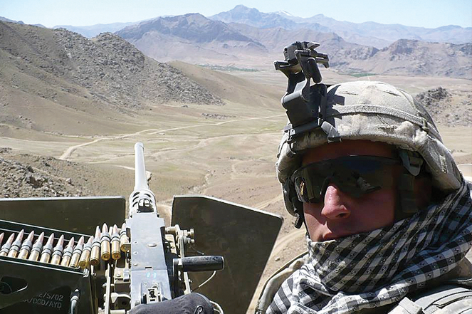 Specialist Graydon Kamp of Dog Company, 1-506th, on overwatch in Nerkh District, Wardak Province, Afghanistan in 2008.