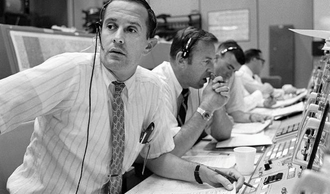 Charlie Duke (left) and other spacecraft communicators keep in contact with Apollo 11 during its lunar landing mission in 1969.