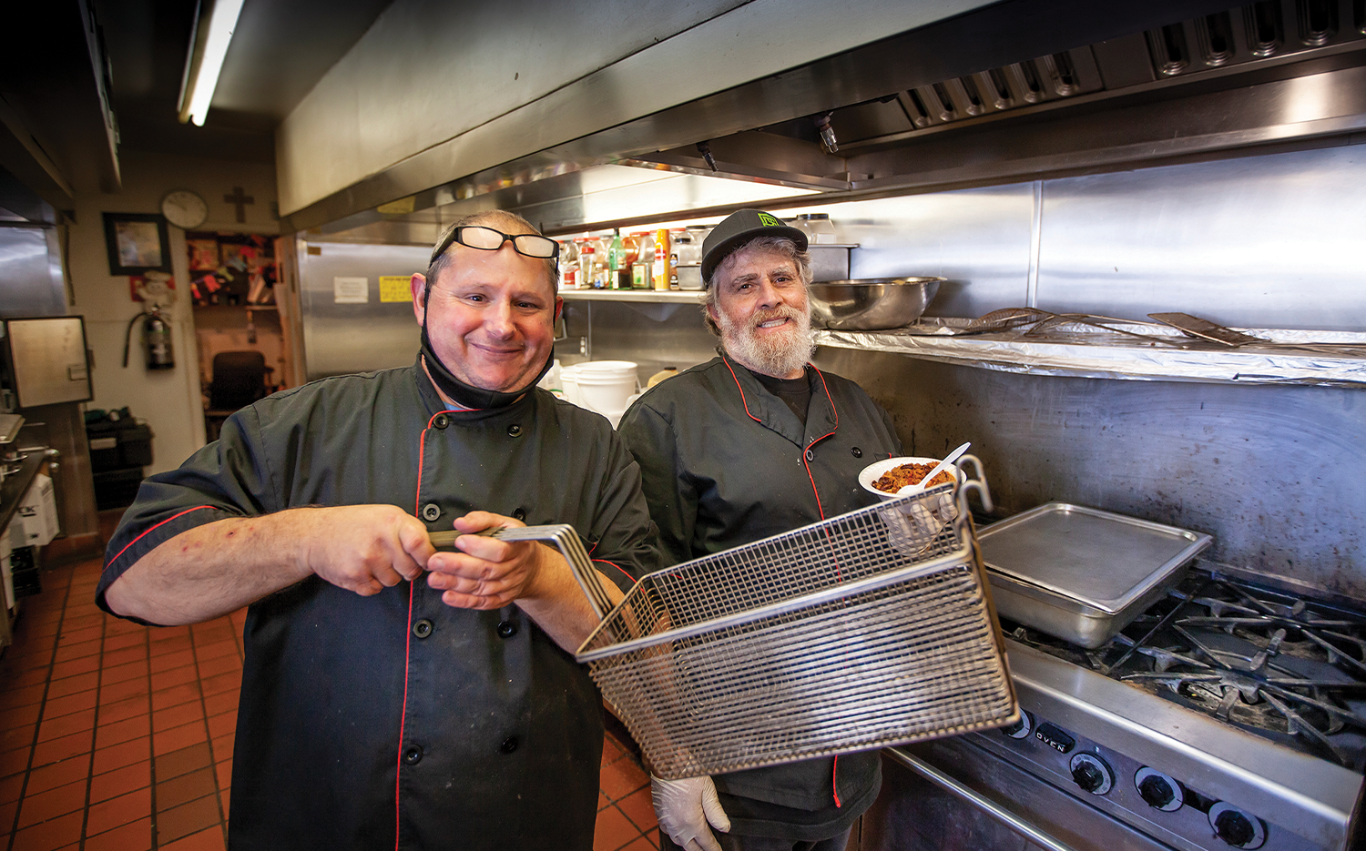 Anthony Ebbe and Tommy Hendricks at work in the kitchen