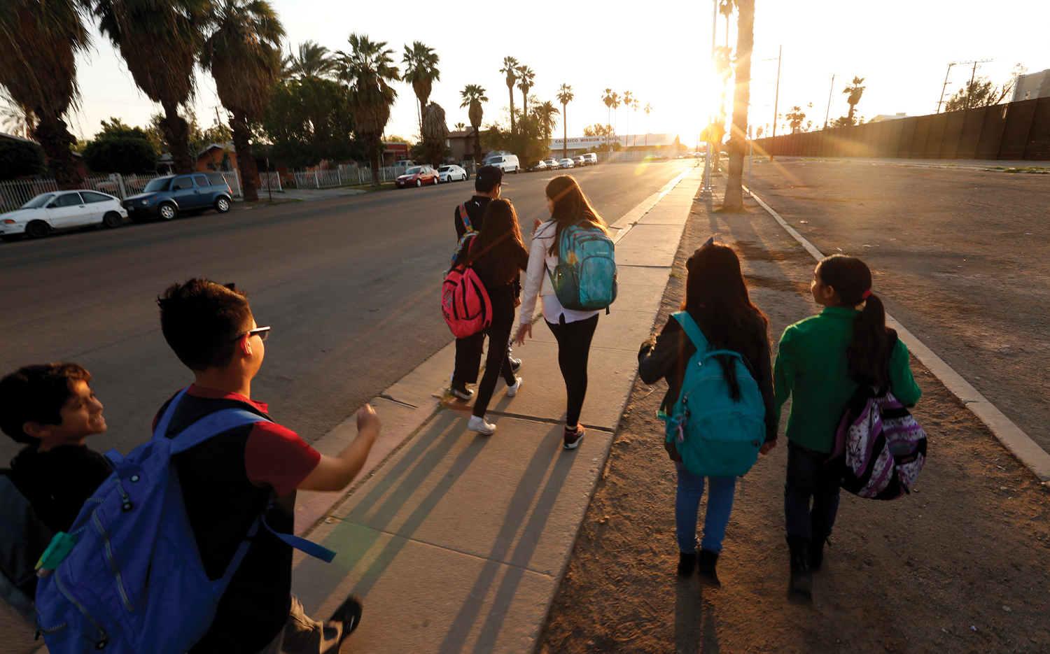 After crossing the border from Mexicali, Mexico, students make their way to school in Calexico, Calif.