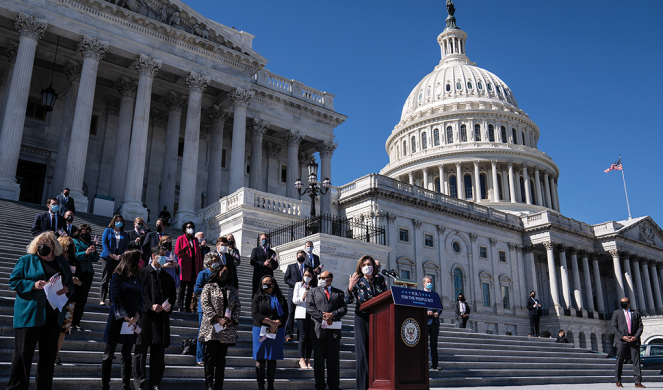 Speaker of the House Nancy Pelosi unveils H.R. 1, the For the People Act, on the steps of the Capitol.