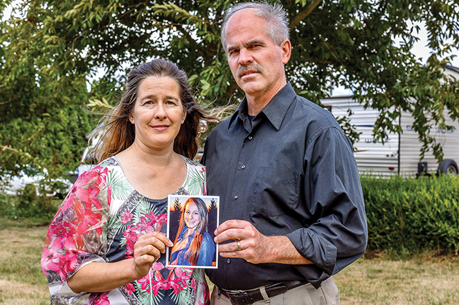 Teresa and Ron Suelzle with Esther's high-school senior photo.
