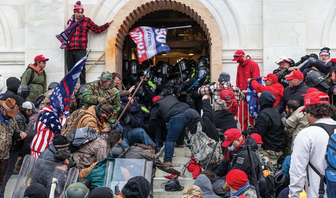 Rioters trying to enter the Capitol building clash with police.