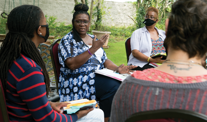 Rachel Dowdell (second from left) leads a Bible study.