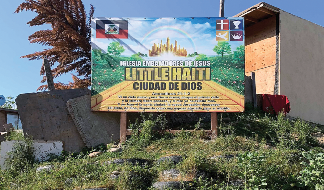 A sign marks the new Haitian development in Scorpion's Canyon.