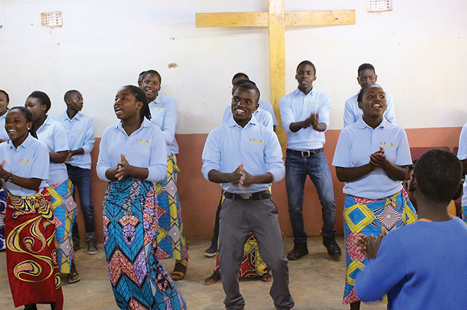 The VOH choir leads music at a Sunday service.