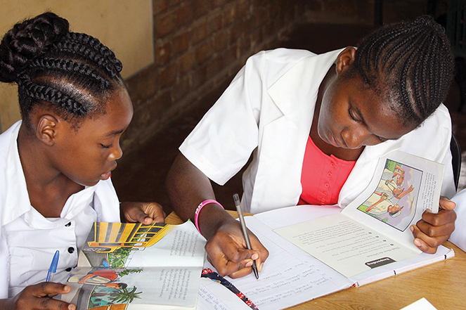 Students practice reading in the School of Hope's sixth-grade class.