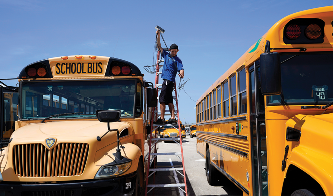 Spencer Hollers works to equip Southside Independent School District buses with Wi-Fi in San Antonio, Texas.