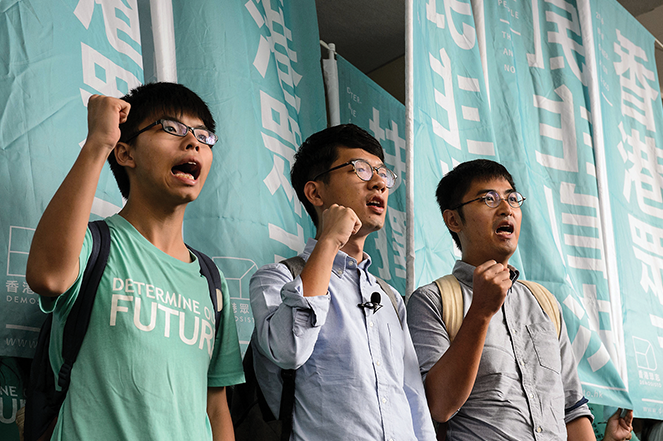 Wong, Law, and Chow (from left to right) in 2016 outside the Eastern Court in Hong Kong