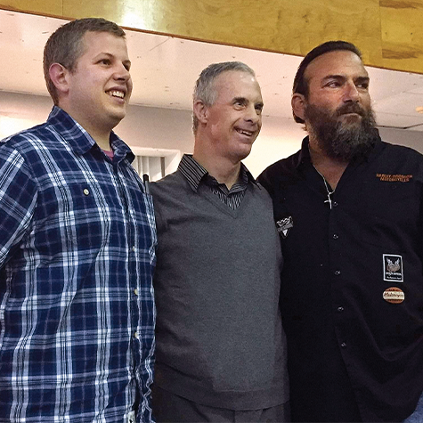 Chris at his surprise party with his current McDonald's manager, Andrew Chaya (left), and Rich Bondanza (right), the manager who hired Chris 30 years ago.