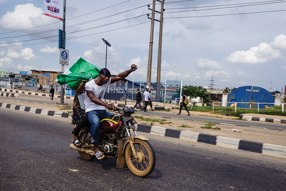 A man in Nigeria raises his fist in protest against oppression.