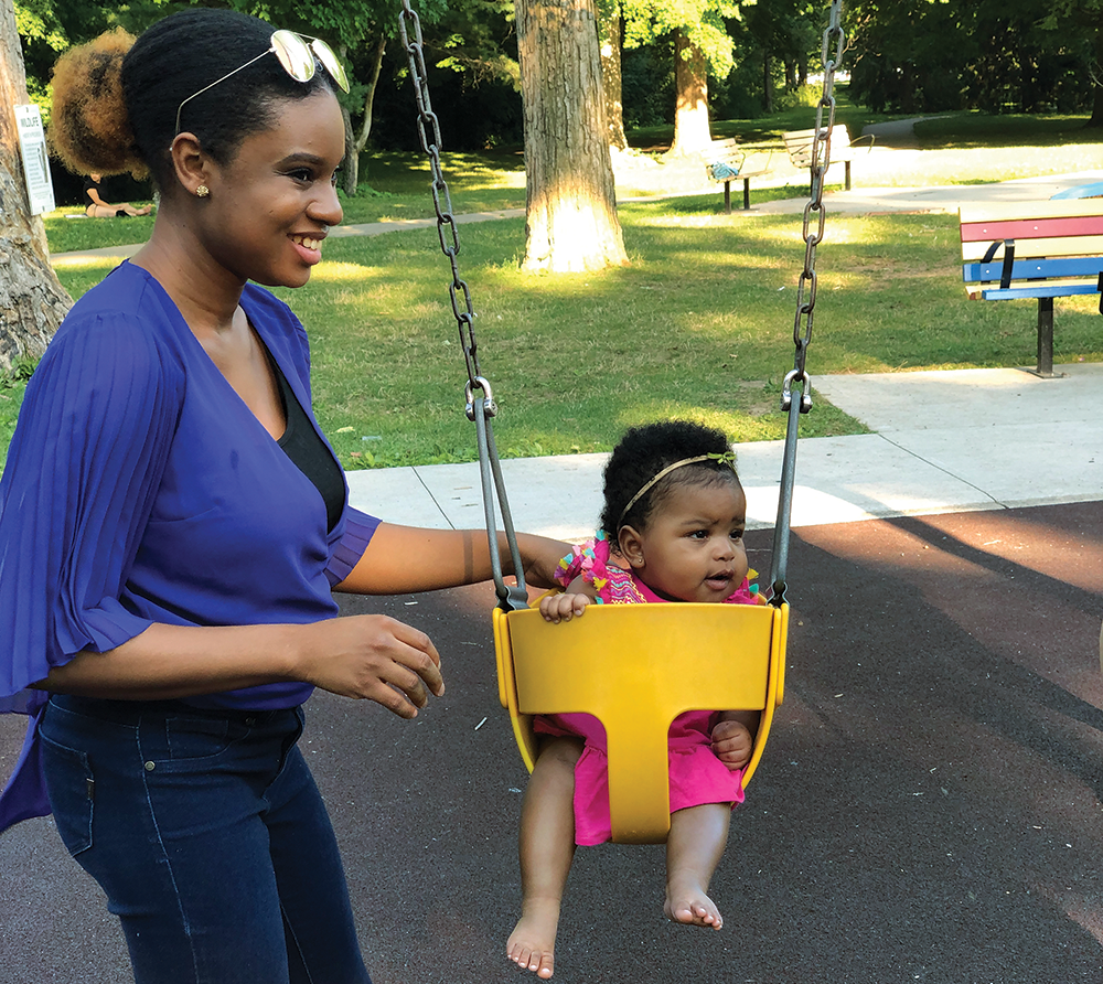 Osariemen Opaluwa plays with her daughter at the park.