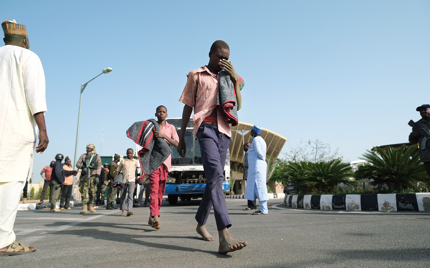 Students from the Government Science Secondary School walk to a government building on Dec. 18, 2020, a day after their release from armed abductors.