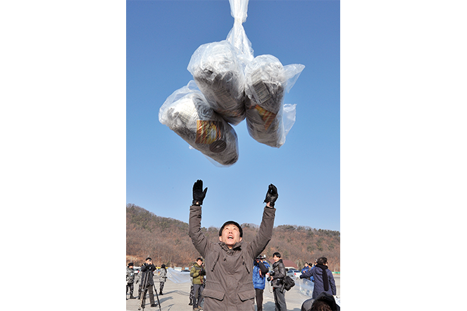 Park Sang-hak releases a balloon carrying leaflets in the border town of Paju, north of Seoul.