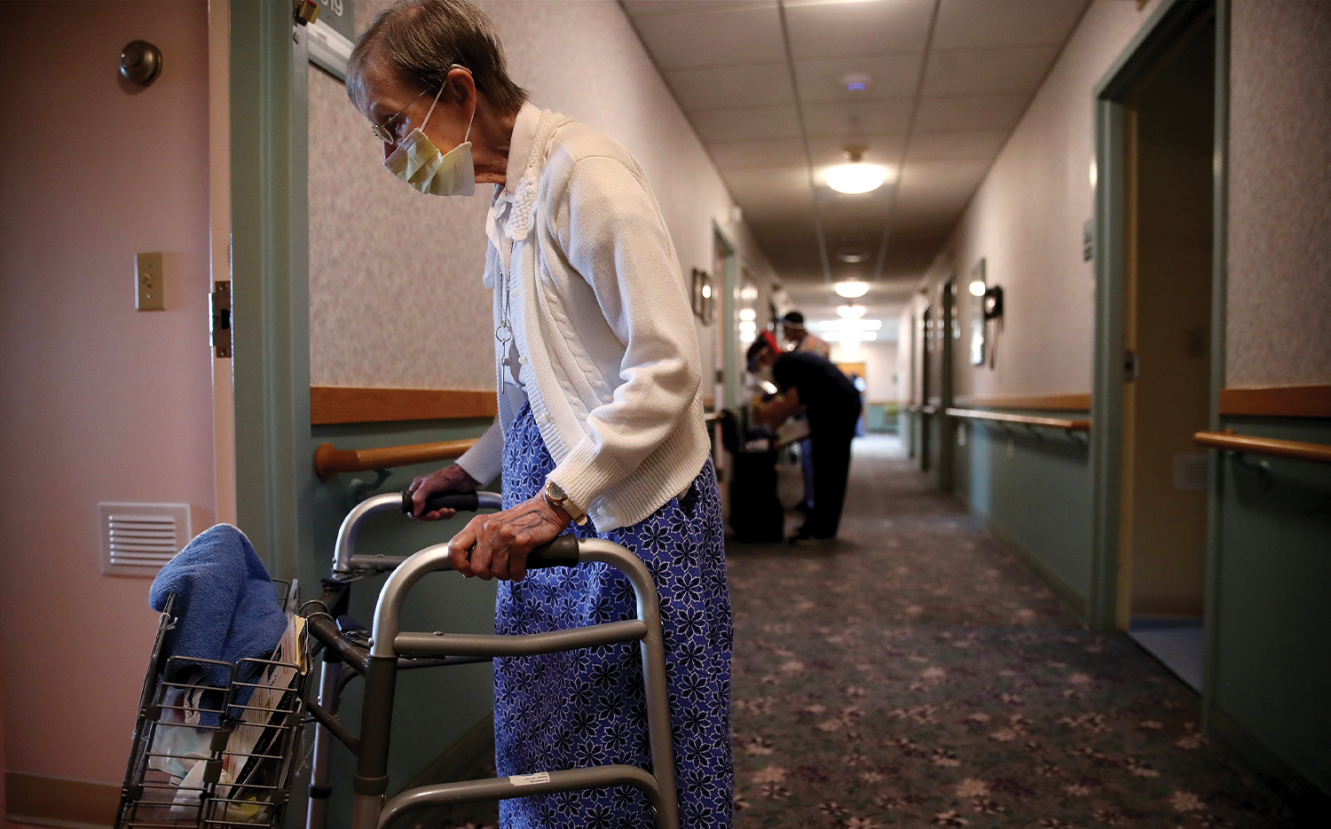 Jeanne Arsenault returns to her room after breakfast at St. Chretienne Retirement Residence in Marlborough, Maine.
