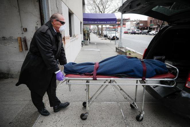 Funeral director Tom Cheeseman collects a body from a nursing home in the Brooklyn, New York.
