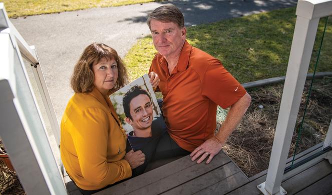 LeeAnn and Chris Cheeley hold a photo of their son Zach.