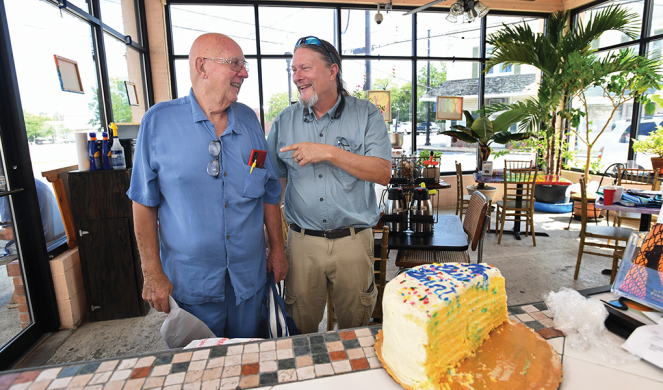 Charlie Powell (left), who came to faith in Christ through Parr and his Bible studies at the café, brought a cake to share.