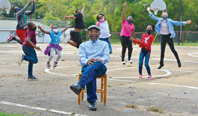 John Perkins with children from the Perkins Center