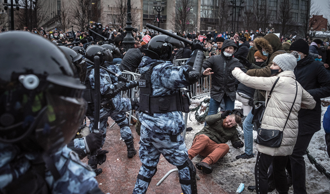 Riot police officers in Moscow clash with demonstrators during a protest against the jailing of Navalny on Jan. 23.