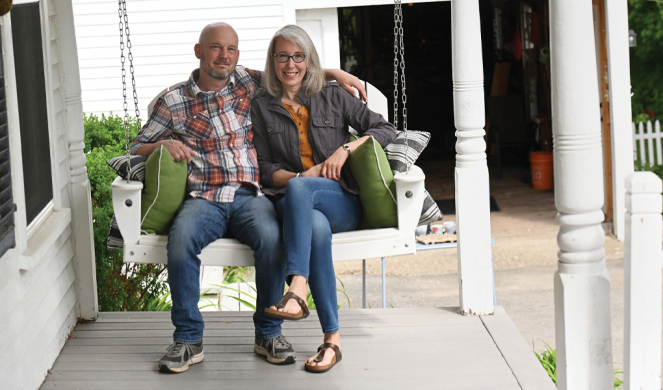 Dan and Lisa Wells outside their home in Richmond, Maine.
