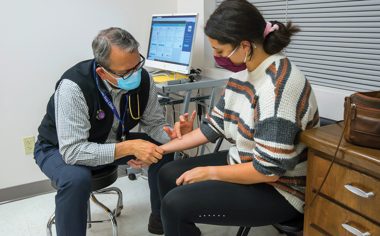 Erickson treats a patient at SHFC.