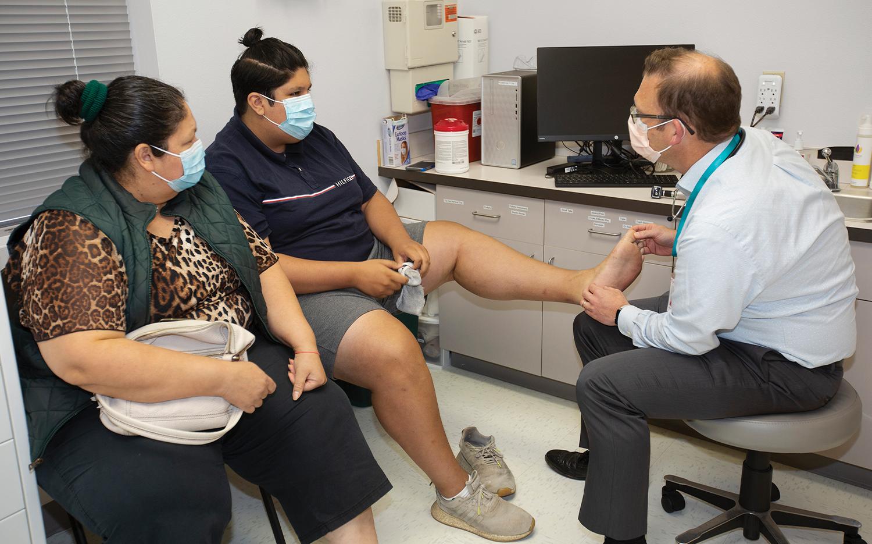 Grierson treats a patient at SHFC.