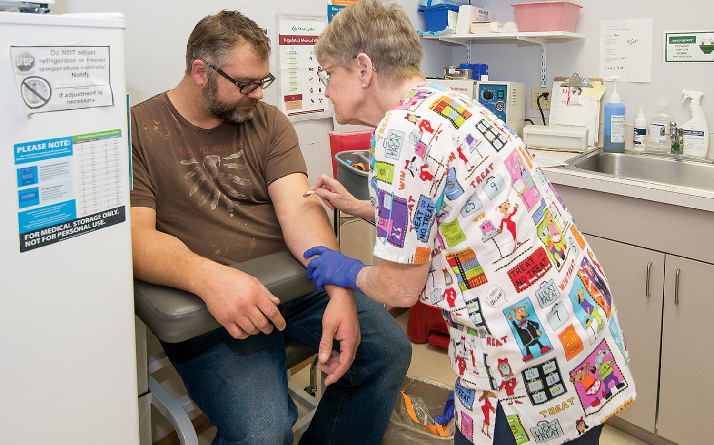 A nurse treats a patient at SHFC.