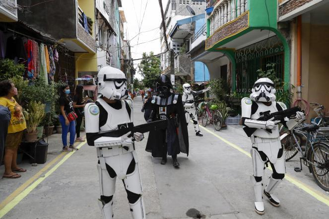 Members of a youth group in Star Wars costumes entertain locals along a road in Malabon, Metro Manila, Philippines, last week.