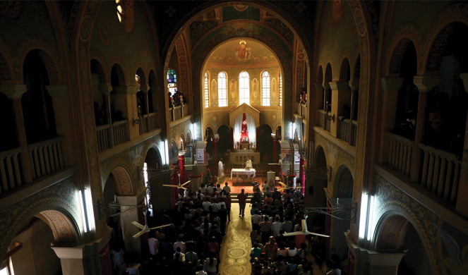 People attend a Christmas Mass at St. Matthew's Cathedral in Khartoum.