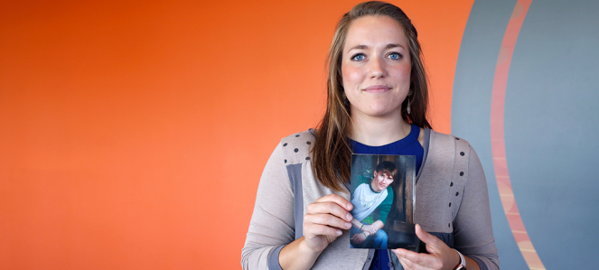 Hannah Bates holds a photo of her brother.