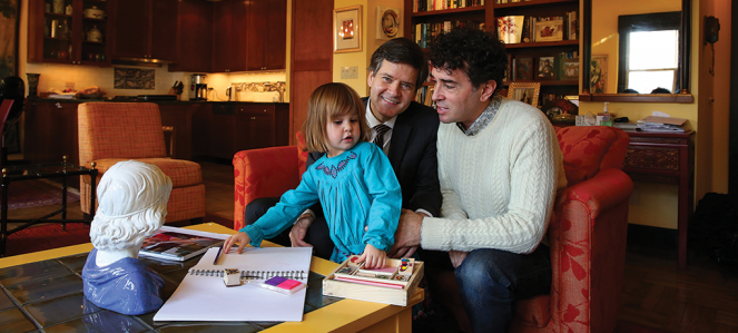 New York state Sen. Brad Hoylman (left) and David Sigal with their daughter, Silvia Hoylman-Sigal, 3, who was born via a surrogate mother, at their home in New York.