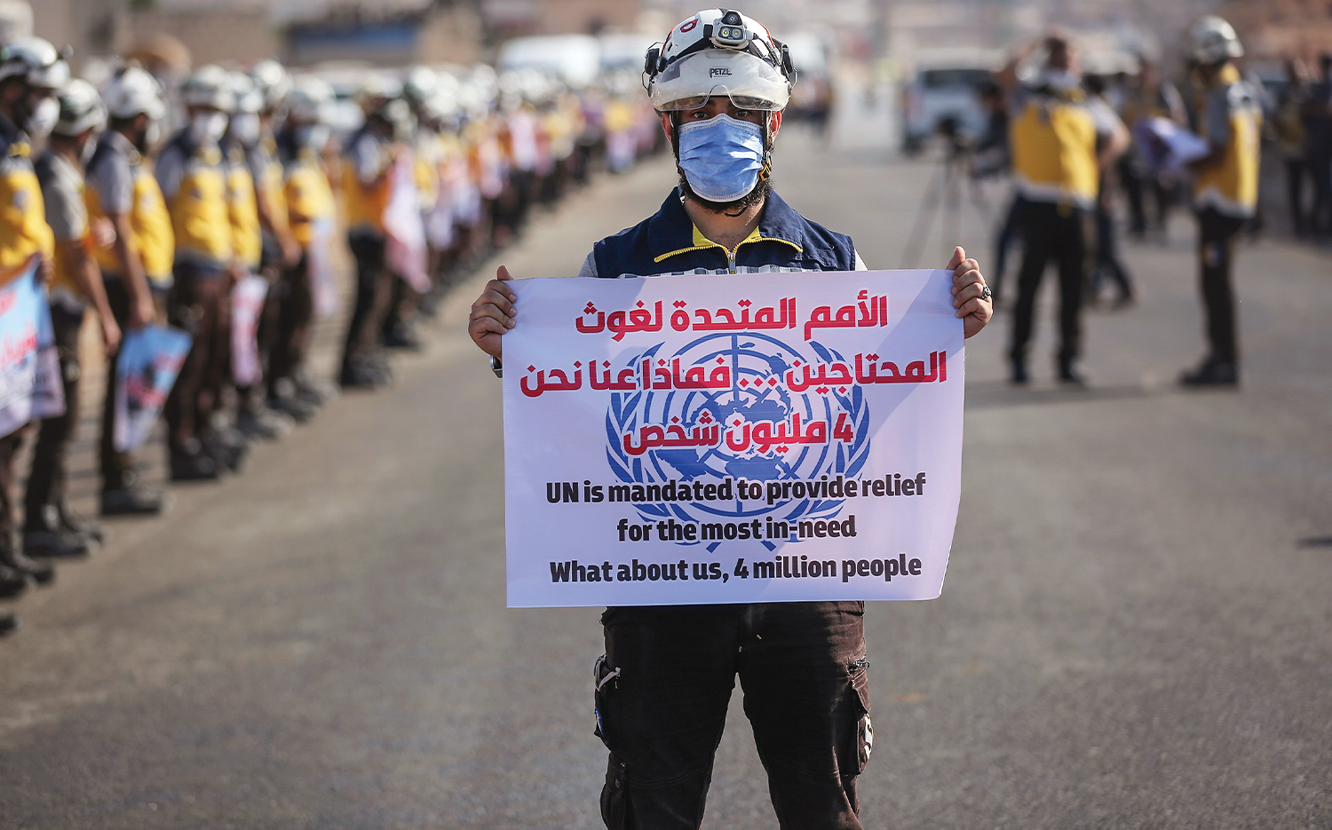 Members of the Syria Civil Defence take part in a protest to demand the extension of its mandate for the entry of humanitarian aid into northwestern Syria.